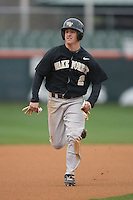 Micah Jarrett #2 of the Wake Forest Demon Deacons hustles into third base at Doug Kingsmore stadium March 13, 2009 in Clemson, SC. (Photo by Brian Westerholt / Four Seam Images)