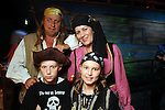 Yolle and Kati Lemberger with their kids Lilli and Sepp at a VIP preview of Real Pirates: The Untold Story of the Whydah from Slave Ship to Pirate Ship at the Houston Museum of Natural Science Wednesday Oct. 06, 2010. (Dave Rossman/For the Chronicle)