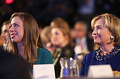 Hillary Rodham Clinton and daughter Chelsea Clinton are viewed in the audience as President Barack Obama, who is in New York City for the 69th Session of the United Nations General Assembly, speaks at the Clinton Global Initiative on September 23, 2014 in New York City. World leaders, activists and protesters have converged on New York City for the annual UN event that brings together the global leaders for a week of meetings and conferences. This year 's General Assembly has highlighted the problem of global warming and how countries need to strive to  reduce greenhouse gas emissions.<br /> Credit: Spencer Platt / Pool via CNP
