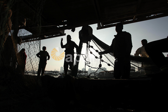 Palestinian fishermen pull their net at the beach in Gaza City, on April 4, 2016. Israel on Sunday extended the distance it permits Gaza fishermen to head out to sea along certain parts of the coastline of the enclave, which is run by the Islamist group Hamas. The fishing zone was expanded from six nautical miles (11 km) to nine (16 km) along Gaza's central and southern shores, a step that Israeli authorities said should result in a bigger catch in deeper waters, where fish are more abundant. Photo by Ashraf Amra