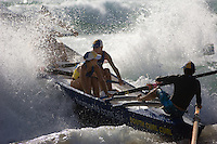 A surf recue boat, rowed by women, ploughs through heavy surf in the annual Manly surf carnival, Sydney, Australia. Although the traditional boats have been replaced by powered zodiacs for actual rescue work, the sport of rowing them remains immensely popular.