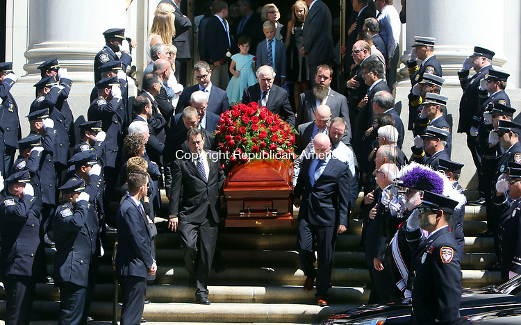 WATERBURY CT. 17 August 2017-081717SV04-Police officers and firefighters salute as the casket of former Mayor Edward &quot;Mike&quot; D. Bergin Jr. leaves the Basilica of the Immaculate Conception during his funeral in Waterbury Thursday. <br /> Steven Valenti Republican-American