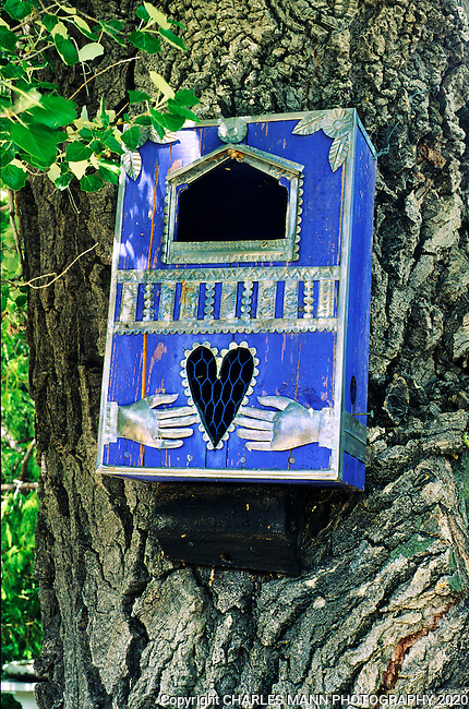 The gardens of Santa Fe, New Mexico, offer a constant supply of delightful surprises and artful delights.Ford Ruthling is one of Santa Fe's most beloved and noteable artists and his garden reveals many hints of his  eclectic and colorful creative gift for the whimsical.