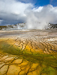 Yellowstone National Park, Wyoming; patterns of orange Thermophiles (algae) in the warm water runoff from Grand Prismatic Spring