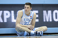 CHAPEL HILL, NC - FEBRUARY 25: Justin Pierce of the University of North Carolina waits by the scorer's table to enter the game during a game between NC State and North Carolina at Dean E. Smith Center on February 25, 2020 in Chapel Hill, North Carolina.