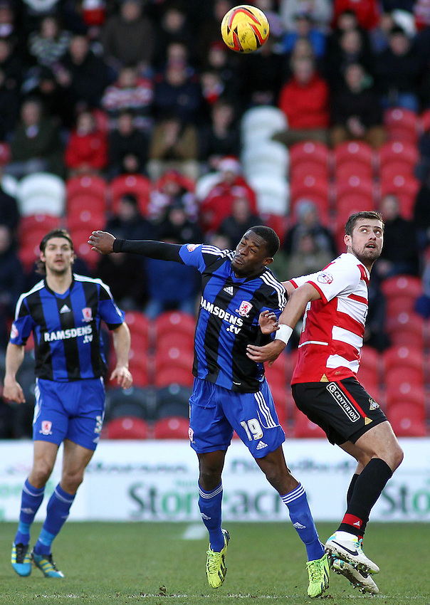Middlesbrough's Mustapha Carayol vies for possession with Doncaster Rovers' Gabriel Tamas<br /> <br /> Photo by Rich Linley/CameraSport<br /> <br /> Football - The Football League Sky Bet Championship - Doncaster Rovers v Middlesbrough - Saturday 1st February 2014 - Keepmoat Stadium - Doncaster<br /> <br /> &copy; CameraSport - 43 Linden Ave. Countesthorpe. Leicester. England. LE8 5PG - Tel: +44 (0) 116 277 4147 - admin@camerasport.com - www.camerasport.com