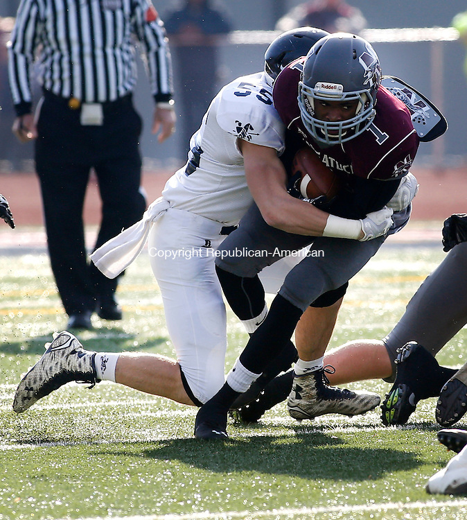 Naugatuck, CT- 26 November 2015-112615CM06-  Ansonia's Keith Zdep (55) takes down Naugatuck's Antoine Sistrunk during their Thanksgiving matchup in Naugatuck on Thursday.  The Chargers would rout the Greyhounds,  41-8.   Christopher Massa Republican-American