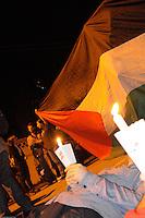 SAO PAULO, SP, 15.07.2014 -  ISRAEL / PALESTINA / VIRGILIA - Vigília na Praça Cinquentenário de Israel, no bairro do Pacaembu, zona oeste da capital paulista, em memória às vítimas do conflito entre Palestina e Israel, na Faixa de Gaza. Os manifestantes pedem o fim da ofensiva militar israelense, que desde o último dia 8 já matou quase 200 pessoas. (Foto: Kevin David / Brazil Photo Press).
