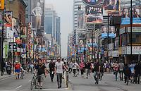 Toronto g20 protest crowds survey property damage on Yonge Street Saturday June 26
