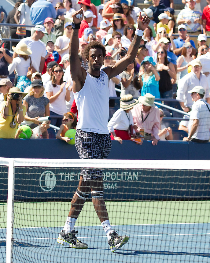 Gael Monfils FRA (17) celebrates his victory over Richard Gasquet FRA in their Men's singles 4th Round match. Gael Monfils FRA (17) def Richard Gasquet FRA 6-4 7-5 7-5..