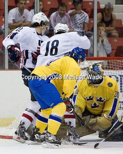 Eric Tangradi (US White - 22), Philip McRae (US White - 18), Jens Westin (Sweden 8), Mark Owuya (Sweden 30) -  - Team Sweden defeated Team USA White 7-3 on Friday, August 8, 2008, in the 1980 Rink during the 2008 US National Junior Evaluation Camp and Summer Hockey Challenge in Lake Placid, New York.