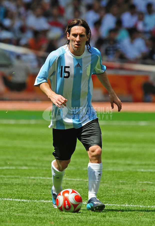 Aug. 23, 2008; Beijing, CHINA; Argentina player Lionel Messi (right) against Nigeria during the mens soccer gold medal game at the National Stadium during the 2008 Beijing Olympic Games. Argentina defeated Nigeria 1-0 to win the gold medal. Mandatory Credit: Mark J. Rebilas-