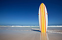 Retro surf board on beach
