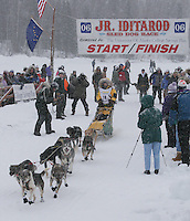 Saturday February 25, 2006 Willow, Alaska.  Ellen King leaves in 18th position at the start day of the Junior Iditarod sled dog race.  Willow Lake.