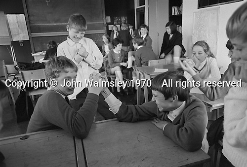 Boys arm wrestling, Whitworth Comprehensive School, Whitworth, Lancashire.  1970.