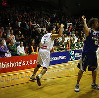 Giants forward Darryl Jones celebrates as Casey Frank protests during the NBL match between the Wellington Saints and Nelson Giants at TSB Bank Arena, Wellington, New Zealand on Friday, 21 May 2010. Photo: Dave Lintott / lintottphoto.co.nz
