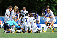26 September 2010:  FIU's team piles onto Katrina Rose after she scored the winning goal as the FIU Golden Panthers defeated the Arkansas State Red Wolves, 1-0 in double overtime, at University Park Stadium in Miami, Florida.