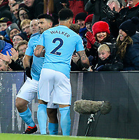 A young Liverpool fan helps Manchester City's Sergio Aguero find the ball in between the seats and advertising boards<br /> <br /> Photographer Alex Dodd/CameraSport<br /> <br /> The Premier League - Liverpool v Manchester City - Sunday 14th January 2018 - Anfield - Liverpool<br /> <br /> World Copyright &copy; 2018 CameraSport. All rights reserved. 43 Linden Ave. Countesthorpe. Leicester. England. LE8 5PG - Tel: +44 (0) 116 277 4147 - admin@camerasport.com - www.camerasport.com