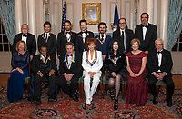 The recipients of the 41st Annual Kennedy Center Honors pose for a group photo following a dinner hosted by United States Deputy Secretary of State John J. Sullivan in their honor at the US Department of State in Washington, D.C. on Saturday, December 1, 2018.  From left to right back row: Deputy Secretary of State Sullivan, Thomas Kail, Lin-Manuel Miranda, Andy Blankenbuehler, Alex Lacamoire, Glenn Weiss, and Ricky Kirshner, Executive Producers with White Cherry. Front row, left to right: Grace Rodriguez, Wayne Shorter, Philip Glass, Reba McEntire, Cher, Deborah F. Rutter and David M. Rubenstein.  The 2018 honorees are: singer and actress Cher; composer and pianist Philip Glass; Country music entertainer Reba McEntire; and jazz saxophonist and composer Wayne Shorter. This year, the co-creators of Hamilton,? writer and actor Lin-Manuel Miranda; director Thomas Kail; choreographer Andy Blankenbuehler; and music director Alex Lacamoire will receive a unique Kennedy Center Honors as trailblazing creators of a transformative work that defies category.<br /> CAP/MPI/RS<br /> &copy;RS/MPI/Capital Pictures