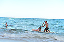 HALLANDALE BEACH, FL - MARCH 17: People Paddleboard and swimming on a almost empty beach. Barricades and Signage indicates that an area of Hallandale Beach is closed on March 17, 2020 in Hallandale Beach, Florida. Republican Florida Gov. Ron DeSantis and Hallandale Beach City officials closed the area of the beach that is popular with college spring breakers and asked them to refrain from large gatherings where COVID-19 could spread on March 17, 2020 in Hallandale Beach, Florida.  ( Photo by Johnny Louis / jlnphotography.com )