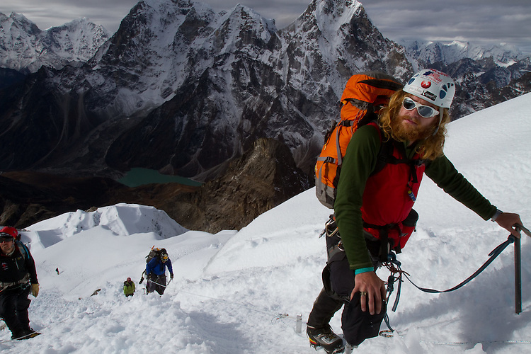 Chad Jukes nearing the summit of Lobuche. Photo by Didrik Johnck.