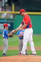 Philadelphia Phillies pitcher Cliff Lee #33 signs autographs for the stars of the game before a Spring Training game against the Boston Red Sox at Bright House Field on March 24, 2013 in Clearwater, Florida.  Boston defeated Philadelphia 7-6.  (Mike Janes/Four Seam Images)