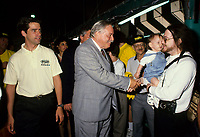 Montreal (Qc) CANADA,August 1998 File Photo <br /> <br /> Parti Quebecois  Leader Jacques Parizeau <br /> shake hand with a father and his baby while Andre Boisclair (L) loook on.<br /> <br /> Photo by Pierre Roussel / Images Distribution