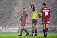 Referee Romain Poite signals in the rain. European Rugby Champions Cup match, between the Scarlets and Bath Rugby on October 20, 2017 at Parc y Scarlets in Llanelli, Wales. Photo by: Patrick Khachfe / Onside Images