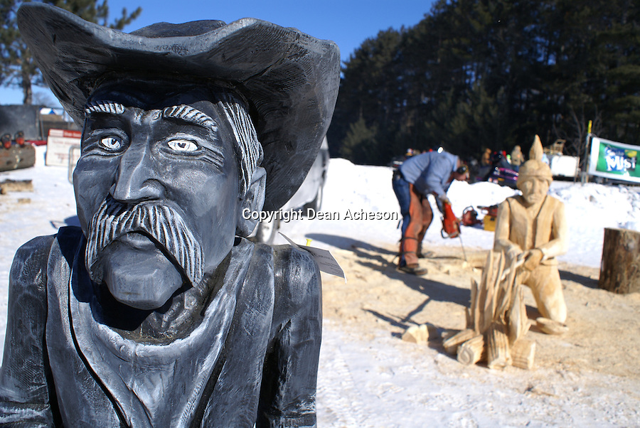 A chainsaw artist works on another creation during the annual Klondike Days in Eagle River, WI. The winter celebration is ranked as among the most popular winter events in the state, featuring reenactors from the 18th Century, sled dog and horse pulls and Native American dances and talks.