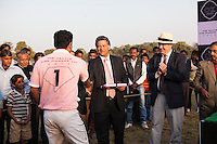 Nik Senapati (center), Managing Director of Argyle Pink Diamonds, presents a gift to a polo player of the Royal Jaipur Polo Team after they win a close match for the Argyle Pink Diamond Cup, organised as part of the 2013 Oz Fest in the Rajasthan Polo Club grounds in Jaipur, Rajasthan, India on 10th January 2013. Photo by Suzanne Lee