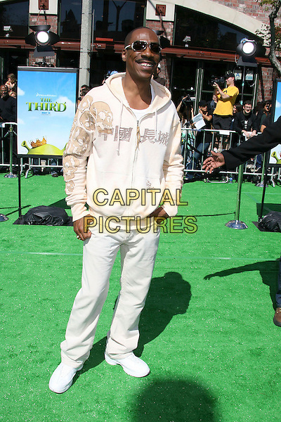 "EDDIE MURPHY.Dreamworks ""Shrek The Third"" Los Angeles Premiere held at the Mann Village Theater, Westwood, California , USA, 06 May 2007..full length cream white hoodie tracksuit top hooded jeans sunglasses trainers.CAP/ADM/RE.©Russ Elliot/AdMedia/Capital Pictures."