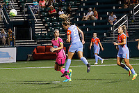 Houston Dash midfielder Cami Privett (23) heads the ball away from Western New York Flash midfielder Abby Erceg (6) during recent NWSL matrch