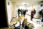 WATERTOWN, CT-011818JS02--Contractors look over the basement area at Heminway School in Watertown Thursday during a pre-bid meeting for those interested in the project to convert the former school into a new town office center. <br /> Jim Shannon Republican-American