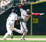 Seattle Mariners' shortstop Yuniesky Betancourt  tags out Boston Red Sox'  Coco Crisp in the sixth inning of their Major League Baseball game Sunday, Aug.  5, 2007 in Seattle. Crist was caught in a pickle while trying to steal third base. .Jim Bryant Photo. ©2010. ALL RIGHTS RESERVED.