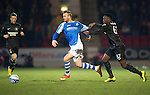 St Johnstone v Celtic.....19.02.13      SPL.Victor Wanyama pulls back Rowan Vine.Picture by Graeme Hart..Copyright Perthshire Picture Agency.Tel: 01738 623350  Mobile: 07990 594431