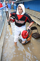 Batavia Muckdogs outfielder Austin Dean (3) steps in the water using a bridge made of chairs after the dugout flooded during a brief but heavy rain storm during a game against the Hudson Valley Renegades on August 8, 2013 at Dwyer Stadium in Batavia, New York.   The game was called due to unplayable field conditions.  (Mike Janes/Four Seam Images)
