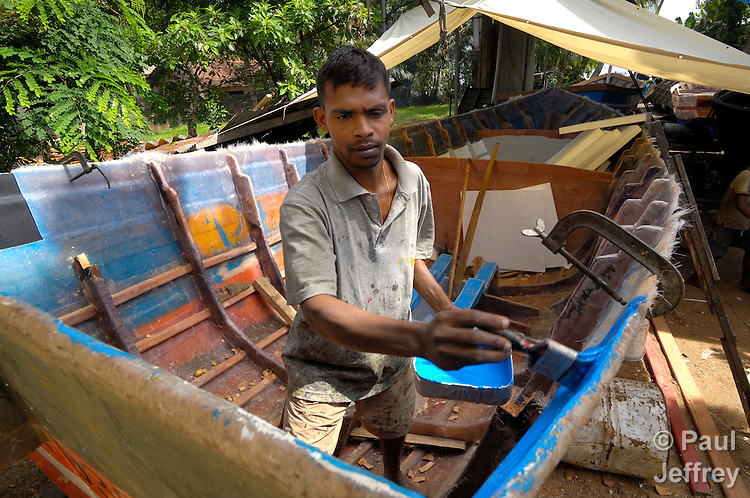 A worker at Diyakawa Marine in Moratuwa, Sri Lanka, works on a boat to replace one of thousands destroyed by the 2004 tsunami. ACT International contracted with this marine construction yard to build boats for hundreds of tsunami survivors.