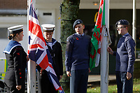 Pictured: Local cadets bring the British and Welsh flags down to observe two minutes silence at Castle Square Gardens in Swansea, Wales, UK. Monday 11 November 2019<br /> Re: Armistice Day, a service to commemorate those who lost their lives in conflict has been held at Castle Square Gardens in Swansea, Wales, UK.