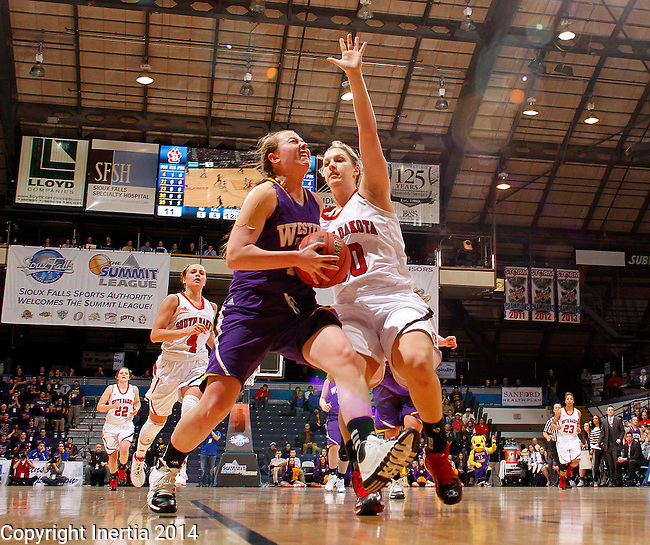 SIOUX FALLS, SD - MARCH 9:  Michelle Maher #14 from Western Illinois drives against Margaret McCloud #30 from the University of South Dakota in the first half of their semifinal game at the 2014 Summit League Tournament in Sioux Falls, SD.  (Photo by Dave Eggen/Inertia)