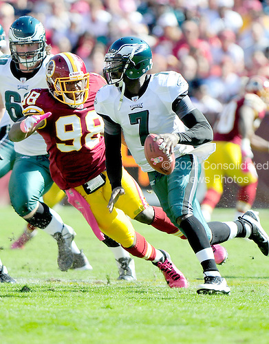 Philadelphia Eagles quarterback Michael Vick (7) scrambles against the Washington Redskins at FedEx Field in Landover, Maryland on Sunday, October 16, 2011.  Redskins linebacker Brian Orakpo (98) pursues on the play.  The Eagles won the game 20 - 13..Credit: Ron Sachs / CNP