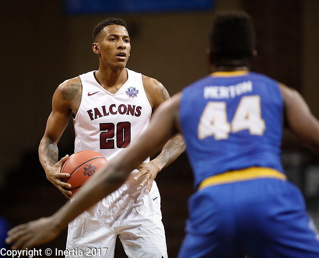 SIOUX FALLS, SD: MARCH 22: homas Wimbush #20 of Fairmont looks past Rollins defender Jeff Merton #44 during the Men's Division II Basketball Championship Tournament on March 22, 2017 at the Sanford Pentagon in Sioux Falls, SD. (Photo by Dick Carlson/Inertia)