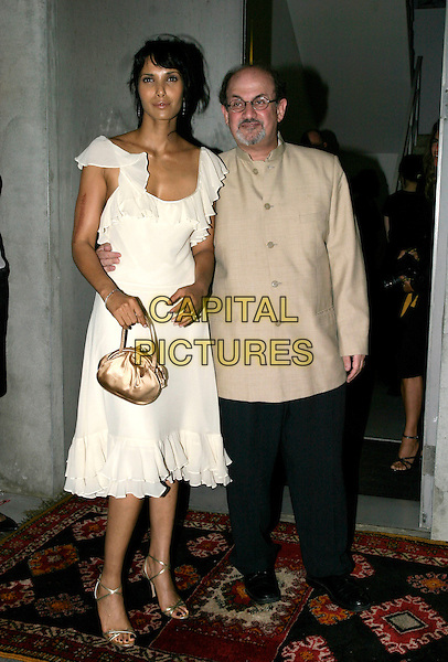 PADMA LAKSHMI & SALMAN RUSHDIE .Salman Rushdie Book Launch at the David Gill Gallery, London, SW11..September 7th, 2005.full length married husband wife walking beige suit jacket white dress summery ruffles arm around waist gold purse.www.capitalpictures.com.sales@capitalpictures.com.© Capital Pictures.