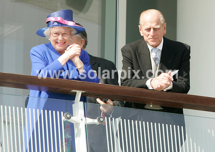 **ALL ROUND PICTURES FROM SOLARPIX.COM**.**WORLDWIDE SYNDICATION RIGHTS**. Queen Elizabeth II and the Duke of Edinburgh  on Saturday celebrated the 54th anniversary of her coronation at the Epsom Downs track for the annual running of the Derby, one of Britain's most prestigious flat horse races. .Wearing a bright blue coat and matching hat with pink trim, the British monarch was escorted through the winners' enclosure into the main grandstand at the track south of London in the early afternoon. .The queen and her husband Prince Philip joined thousands who came to see whether champion jockey Frankie Dettori can win the Epsom Derby at his 15th attempt. .Dettori, a 36-year-old Italian whose best previous finish was second on Tamure in 1995, rides Authorized for one-time winning Derby trainer Peter Chapple-Hyam and is likely to start as the hottest favourite for years. .Authorized will face up to 18 rivals with recordbreaking Irish handler Aidan O'Brien -- a two-time winner with Galileo in 2001 and High Chaparral in 2002 -- having eight of those still involved. .For the coronation anniversary, a 41-gun Royal Salute was fired by The King's Troop Royal Horse Artillery at Green Park, London, at noon and a 62-gun salute by the Honourable Artillery Company at the Tower of London took place an hour later. .Although the queen acceded to the throne on February 6, 1952, on the death of her father George VI, she was not crowned until 16 months later, on June 2, 1953, at Westminster Abbey in London..JOB REF: 4026-RSR        DATE:02_06_07.**MUST CREDIT SOLARPIX.COM OR DOUBLE FEE WILL BE CHARGED* *UNDER NO CIRCUMSTANCES IS THIS IMAGE TO BE REPRODUCED FOR ANY ONLINE EDITION WITHOUT PRIOR PERMISSION*