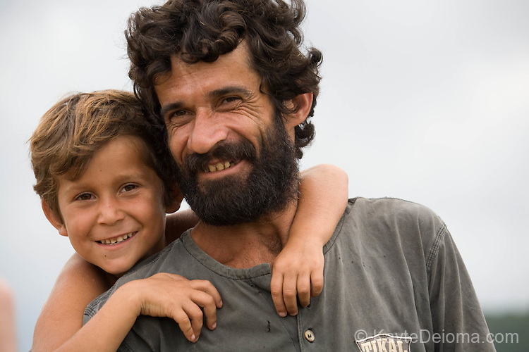 Pedro and his son Gustavo in Imbituba, Santa Catarina, Brazil. Pedro eeks out a meager living in a poor community at the edge of Imbituba. Even in the poorer areas of Santa Catarina, which is one of the wealthier states in Brazil, there is a sense of optimism lacking in the favelas of Rio.