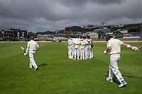 Players walk out for the start of day one of the Plunket Shield cricket match between the Wellington Firebirds and Otago Volts at Basin Reserve in Wellington, New Zealand on Monday, 21 October 2019. Photo: Dave Lintott / lintottphoto.co.nz