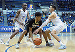 December 19, 2016:  Colorado guard, Dominique Collier #15, is double-teamed by Falcon's, CJ Siples #2 and Hayden Graham #35, during the NCAA basketball game between the University of Colorado Buffaloes and the Air Force Academy Falcons, Clune Arena, U.S. Air Force Academy, Colorado Springs, Colorado.  Colorado defeats Air Force 75-68.