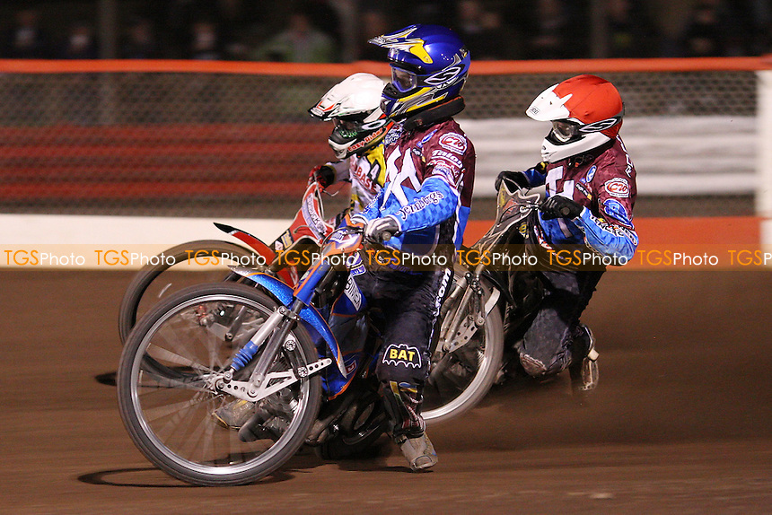 Heat 8: Daniel Davidsson (blue), Stuart Robson (blue) and Ben Barker (white) - Lakeside Hammers vs Coventry Bees, Elite League Speedway at the Arena Essex Raceway, Purfleet - 09/04/10 - MANDATORY CREDIT: Rob Newell/TGSPHOTO - Self billing applies where appropriate - 0845 094 6026 - contact@tgsphoto.co.uk - NO UNPAID USE.