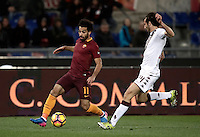 Calcio, Serie A: Roma, stadio Olimpico, 19 febbraio 2017.<br /> Roma&rsquo;s Mohamed Salah (l) in action with Torino's Emiliano Moretti (r) during the Italian Serie A football match between As Roma and Torino at Rome's Olympic stadium, on February 19, 2017.<br /> UPDATE IMAGES PRESS/Isabella Bonotto