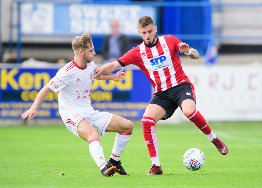 Lincoln City's trialist vies for possession with Lincoln United's trialist<br /> <br /> Photographer Chris Vaughan/CameraSport<br /> <br /> Football Pre-Season Friendly (Community Festival of Lincolnshire) - Lincoln City v Lincoln United - Saturday 6th July 2019 - The Martin & Co Arena - Gainsborough<br /> <br /> World Copyright © 2018 CameraSport. All rights reserved. 43 Linden Ave. Countesthorpe. Leicester. England. LE8 5PG - Tel: +44 (0) 116 277 4147 - admin@camerasport.com - www.camerasport.com