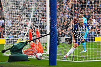 Neal Maupay of Brighton and Hove Albion scores the first goal as Hugo Lloris of Tottenham Hotspurr lies injured  during Brighton & Hove Albion vs Tottenham Hotspur, Premier League Football at the American Express Community Stadium on 5th October 2019
